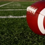 close up football on field image photo