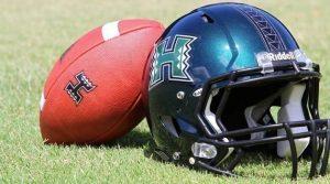 University of Hawaii football team helmet and football
